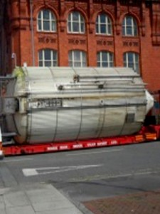 An 880 hl dual-purpose fermentation vessel loaded to transport with full road closure at Cains Brewhouse